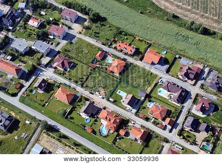 a settlement with many eini lien h�?�?�?�¤suern and swimming pools from the air