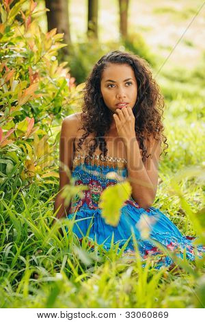 Pretty African American Woman Outside on Beautiful Sunny Day Sitting in the Grass