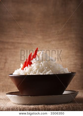 Rice Bowl With Fresh Chillies On Brown Rustic Background