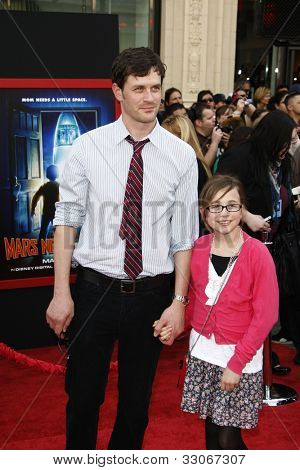 LOS ANGELES - MARCH 6: Tom Everett Scott and daughter Arly at the World Premiere of 'Mars Needs Moms' held at the El Capitan Theater in Los Angeles, California on March 6, 2011