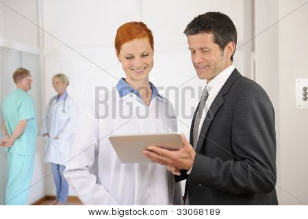 Businessman with Female Doctor at the Hospital