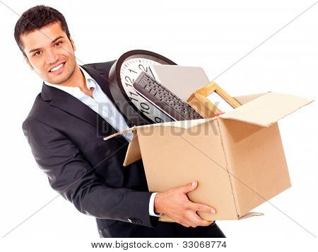 Businessman moving into a new office holding a box - isolated