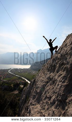 Female rock climber with outstretched arms