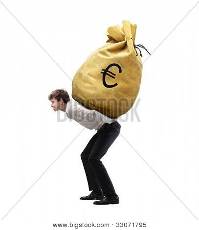 Isolated young businessman carrying a money-bag on his shoulders