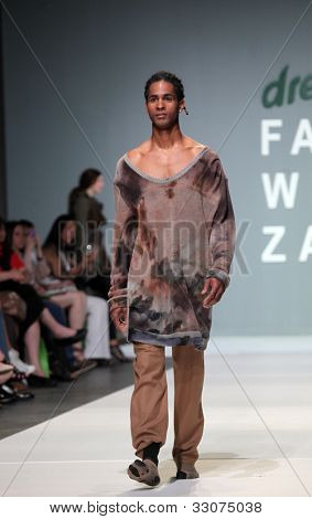 "ZAGREB, CROATIA - MAY 11: Fashion model wears clothes made by Julia and Ben on ""ZAGREB FASHION WEEK"" show on May 11, 2012 in Zagreb, Croatia."