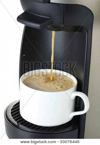 Espresso machine pouring coffee in cup isolated on white