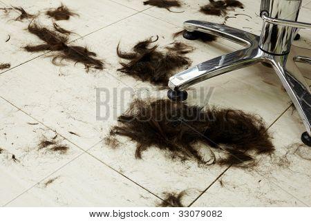 Cut hair on the floor in a hairdressing salon.