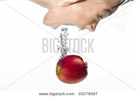 Girl Plunges In For The Apple.