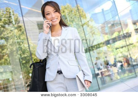 Asian Business Woman On Cell Phone