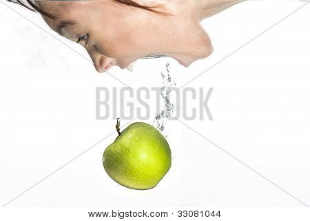 Girl Goes For The Apple.