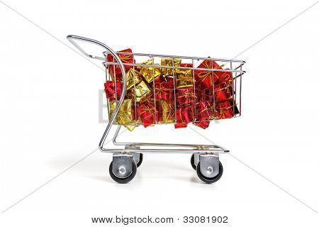 Bunch of gifts in a shopping cart - side view on white background