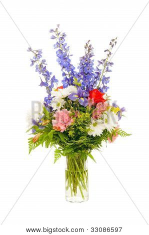 Colorful fresh flower arrangement centerpiece with purple iris, rose, carnation, daisy and delphiniu
