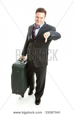 Dissatisfied business traveler giving thumbs down on his travel experience.