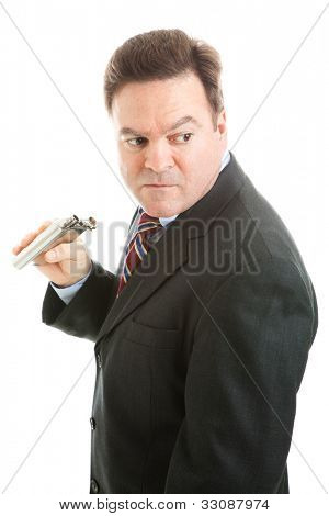 Middle-aged businesman sneaks a drink from a flask.  Isolated on white.