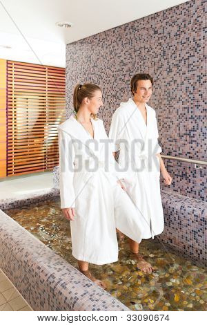 Man and woman while wellness water treading or hydrotherapy