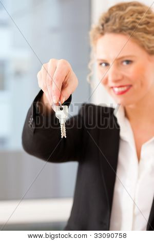 Young realtor is with keys in an apartment, it could be the tenant too