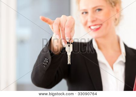 Young realtor is with keys in an apartment; it could be the tenant too