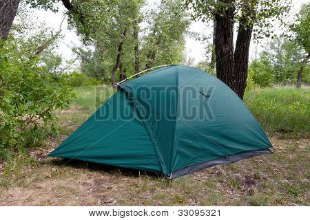 tourist tent in forest camp in summer time