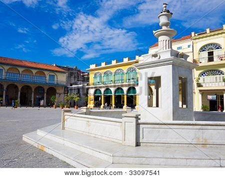 The Old Square with its white marble fountain, in spanish known as Plaza Vieja, a touristic landmark famous for its colonial architecture in Old Havana