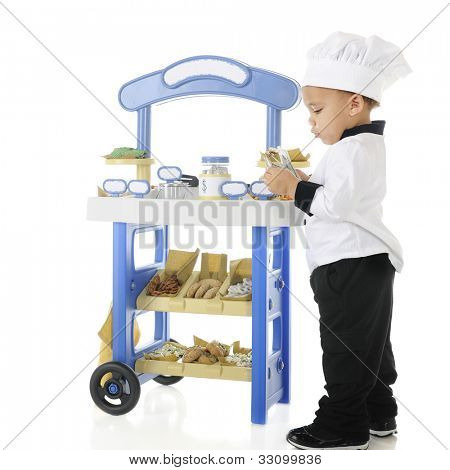 "An adorable biracial preschool ""baker"" counting the money he's made from his vendor stand.  The stand's signs are left blank for your text.  On a white background."