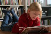 image of girl reading book  - a little girl reading a book - JPG