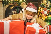 Happy New Year. Child With Big Gift Box. Christmas Child Holding A Huge Gift Box. Little Santa Claus poster