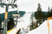 Ski Slope With Lift On The Background Of Evergreen Carpathian Forest, Bukovel Resort, Carpathians, U poster