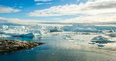 Iceberg and ice from glacier in arctic nature landscape on Greenland. Aerial image drone image of ic poster