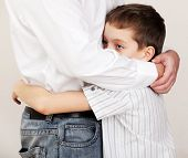 stock photo of sad  - Father comforts a sad child - JPG