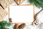 Merry Christmas And Happy New Year. Mockup With Postcard And Branches Of A Christmas Tree On White B poster