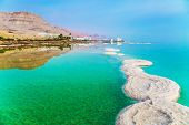 Israel. Early morning at the resorts of the Dead Sea. Azure sea water is full of healing salts. Smal poster