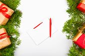 Notebook With Pen On Christmas Background. Empty White Notebook And Pen On White Christmas Backgroun poster