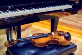 Violin And Piano On Wooden Background. poster