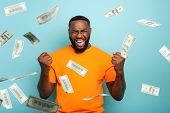 Boy Wins Money. Amazed And Surprised Expression Face. Light Blue Background poster