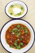 foto of tagine  - A meal of chicken tagine stew in a spicy - JPG