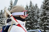 Young, Beautiful Girl In White Ski Suit, With Grey Cap, Googgles And Ski Sticks Using Cable Car, Ski poster