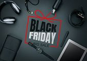 Top View Of Gadgets With Black Friday Lettering On Black Background. Copyspace For Your Ad. Black Fr poster
