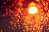 Orange Night Light Bokeh Background. City Life. Blur Abstract Background Of Urban Light. Warm Light  poster