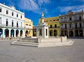 The Old Square with its white marble fountain, in spanish known as Plaza Vieja, a touristic landmark famous for its colonial architecture in Old Havana poster