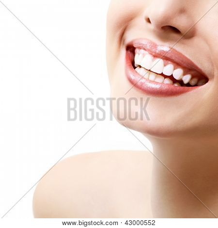 Smile. Young beautiful woman with perfect smile over white background