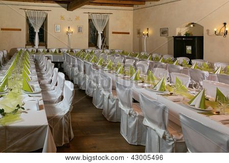 Look at the tables prepared for the celebration in a restaurant