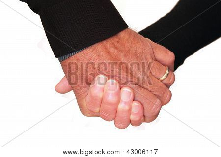 A senior married couple holding hands isolated on a white background