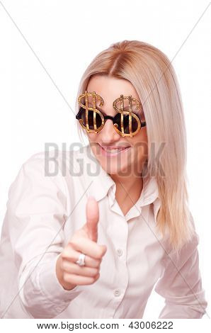 Beautiful brunette with Dollar sign sunglasses, showing thumbs up