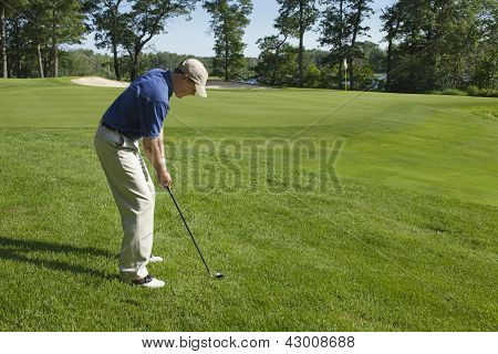 Golfer Chipping Onto Green