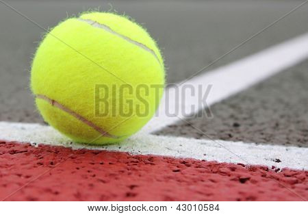 Tennis Ball on a court line
