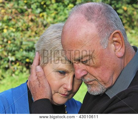 Senior man comforting beautiful wife