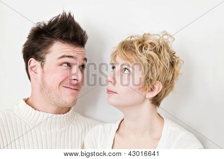 Young Couple looking at each other' hair