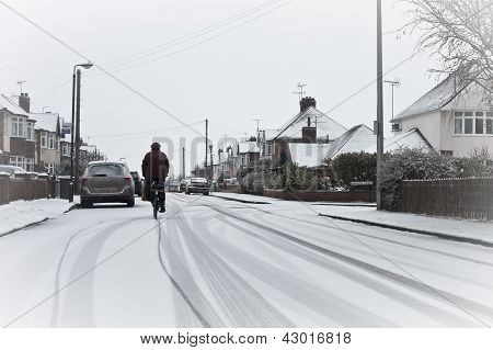 Cyclist In The Snow