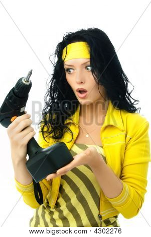 Surprised Young Woman With A Drill