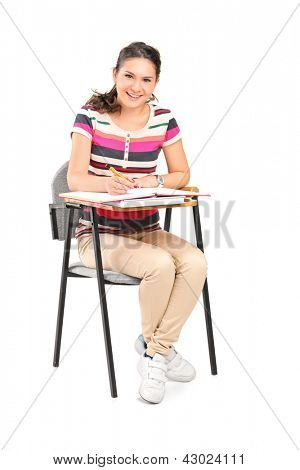 A smiling woman  sitting on a chair and writing down notes isolated on white background